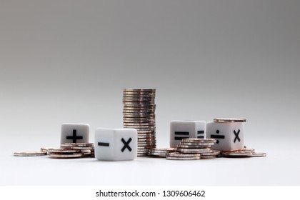 Coins and arithmetic symbol cubes.