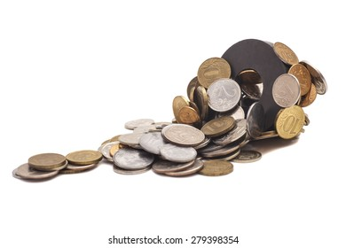 Coins attracted by  magnet isolated on white background