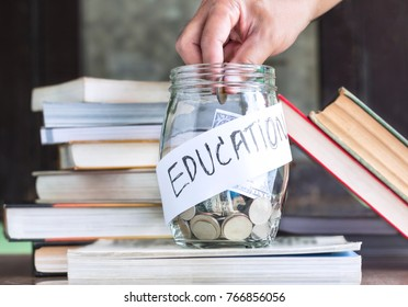 Coins and banknote in a glass jar placed on the textbook. Concept money saving for education.