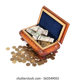 Coins and banknotes in the box isolated