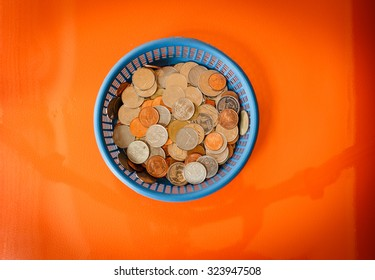 Coins in basket