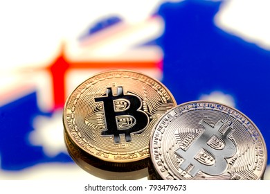coins Bitcoin, against the background of Australia and the Australian flag, concept of virtual money, close-up. Conceptual image of digital crypto currency.