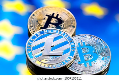 coins Bitcoin and litecoin, against the background of Europe and the European flag, the concept of virtual money, close-up. Conceptual image of digital crypto currency.