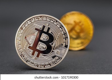 Coins of bitcoin on black background.
