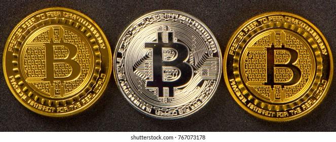 Coins bitcoin on a black background closeup