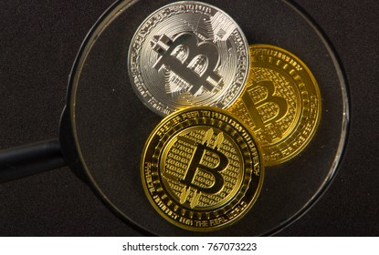 Coins bitcoin on a black background closeup