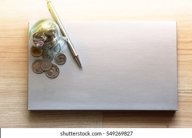 Coins in the bottle with the blank silver paper for note in finance,saving and banking concept