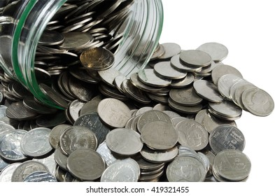 Coins and the bottle on white background