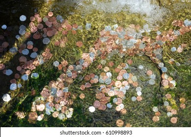 Coins at the bottom of the fountain