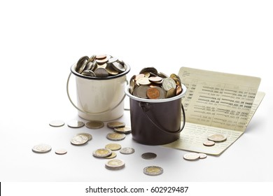 Coins in buckets and saving account passbook, book bank on white background