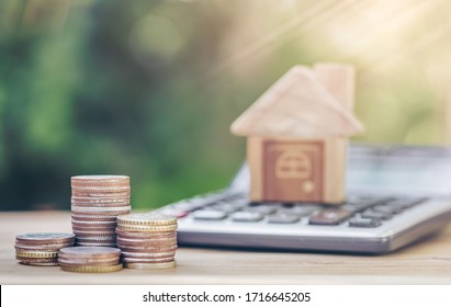 Coins and a calculator placed on the table. concept of calculation in saving money. planning savings money of coins to buy a home concept for property, mortgage, real estate invest, savings buy a home