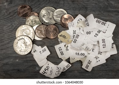 Coins, change and price stickers on a wooden table