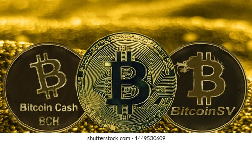 Coins cryptocurrency Bitcoin Cash SV and gold fabric background. Token BCH BSV BTC