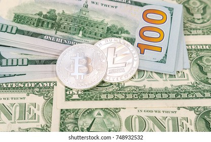 Coins of cryptocurrency lying over american dollar bills. Business concept