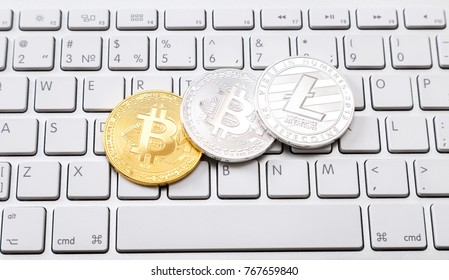 Coins of cryptocurrency lying over computer keyboard. Business concept of worldwide cryptocurrency