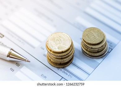 Coins, euro and ball write are provided for a tax return