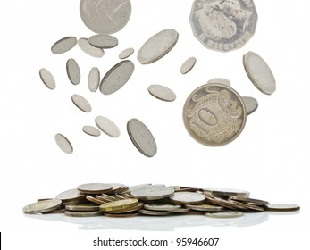 Coins falling with pile of money