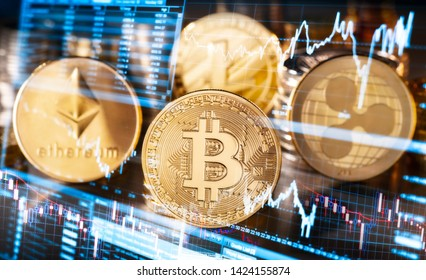 Coins of the four highest-priced cryptocurrencies with symbols of fluctuating exchange rates