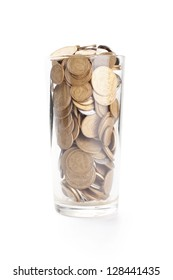 Coins in a glass cup isolated on white background