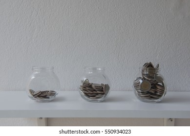 Coins in a glass jar, concept Saving Money  step with deposit coin in bank stack growing business.