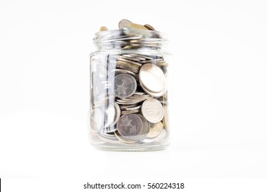 Coins in glass jar for giving and pension concep isolated on white background