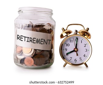 Coins in glass jar for retirement with retro alarm clock
