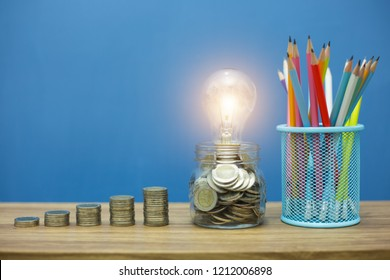 Coins in glass jar saving money for education and financial concept.