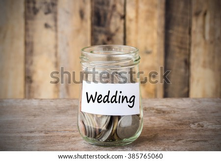 Coins In Glass Money Jar With Wedding Label Financial Concept Vintage Wooden Background