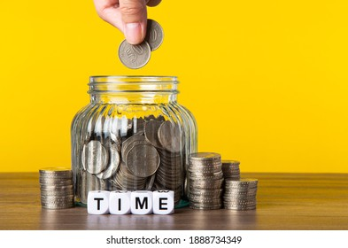 A lot coins in glass money jar with yellow background. Saving for Investment concept.