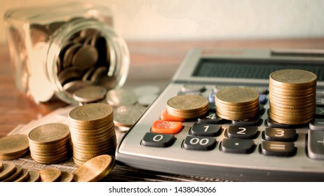 Coins and graphs on calculators for calculating financial and business concepts