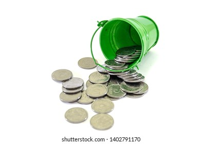 coins in a green bucket isolated on white background. Ukrainian pennies.