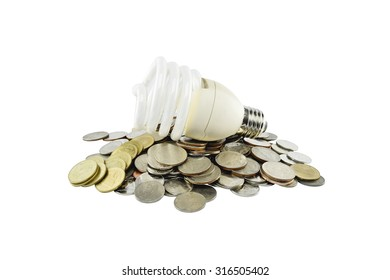 Coins heap with light bulb  (energy savings concept) on white background with clipping paths.