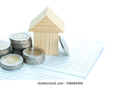 coins with house and bank account on  white background. Finance,saving for buying house and banking concept