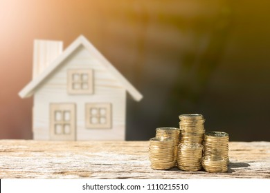 Coins and house blur background show savings to buy a home or buy real estate. Or show a home loan Or divide the investment for retirement. Or for the future Concept of money