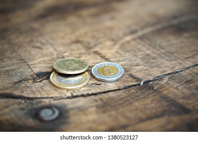 Coins of Hungarian Forints on an old vintage wooden table.