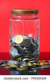 Coins in jar - financial concept