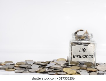 coins in jar with life insurance label in isolated white background; financial concept