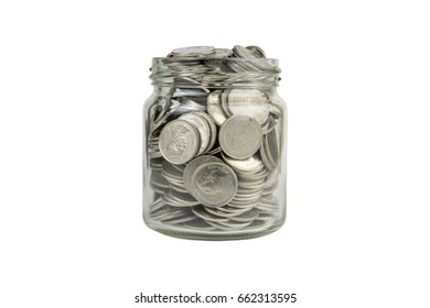 Coins in jar on white background