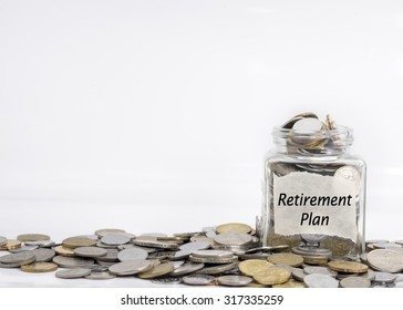 coins in jar with retirement plan label in isolated white background; financial concept