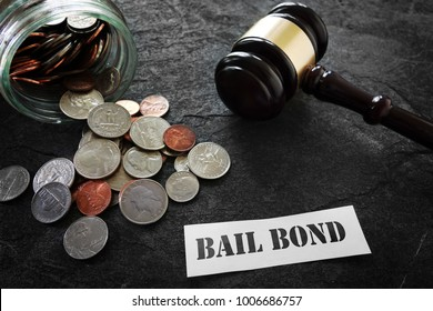 Coins and legal gavel with paper Bail Bond message