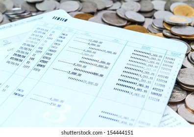 coins on bank account book