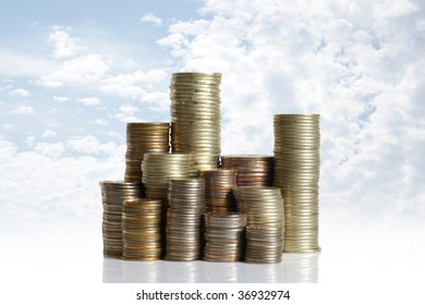 Coins on blue sky background