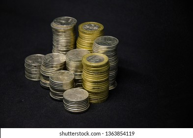 Coins on a dark background. Coins Kazakhstan tenge on a dark background. Kazakh money. Coins of tenge. large pile of coins