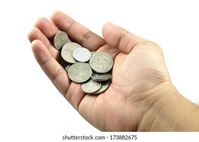 Coins On Hand With White Background