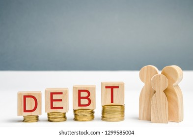 Coins on the rise, wooden blocks with the word Debt and family. Financial difficulties. There is a growing debt for housing, a house / apartment. Mortgage. High interest rates. Unable to pay off debts