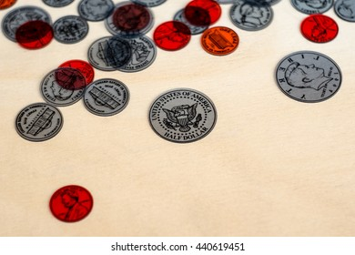 coins on a wooden floor