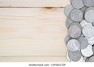 coins on wooden table