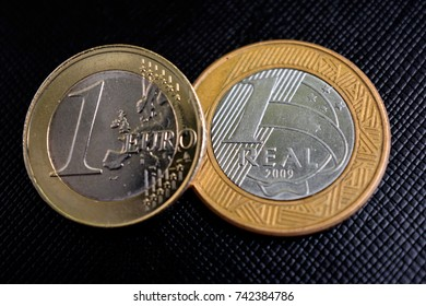 Coins of one euro and real