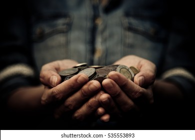 A coins in people hands in saving money concept