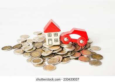 coins in pile and house, car isolated image